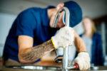 plumber-fixing-kitchen-sink-BU7VF8A.jpg